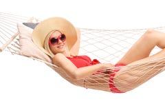 Beautiful blond woman lying in a hammock Royalty Free Stock Photo