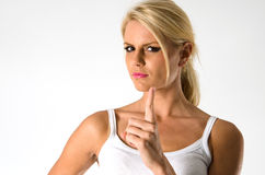 Beautiful blond woman making warning sign Stock Photo