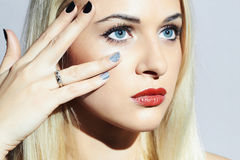 Beautiful blond Woman with Manicure.Beauty Girl.shellac Nail design.young woman with red lips stock photo