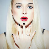 Beautiful blond Woman with Manicure.Sexy Beauty Girl.Make-up Stock Images