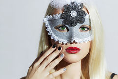 Beautiful Blond Woman in Mask.Young Girl with red lips.Manicure Royalty Free Stock Photography