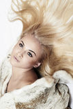 Beautiful blond woman in mink fur on the floor. long hair Stock Images