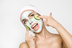 Beautiful blond woman with moisturized face mask. Beauty spa royalty free stock image