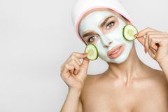 Beautiful blond woman with moisturized face mask. Beauty spa stock images