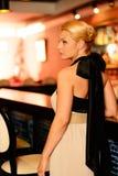 Beautiful blond woman near bar counter Royalty Free Stock Image