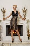 Beautiful blond woman near the fireplace Stock Photo