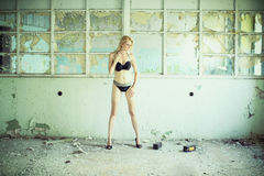 Beautiful blond woman in a old building Stock Image