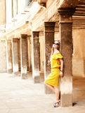 Beautiful blond woman on the street of the old town Royalty Free Stock Photography