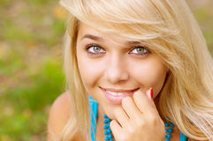 Beautiful blond woman outdoors Stock Photos