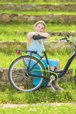 Beautiful Blond Woman Outdoors Enjoying Nature with Bicycle Stock Image