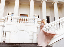 Beautiful blond woman outdoors on the stairs Royalty Free Stock Photo