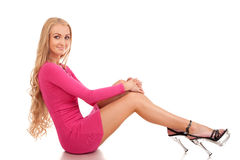Beautiful blond woman in pink dress Royalty Free Stock Image