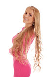Beautiful blond woman in pink dress Royalty Free Stock Photography