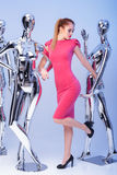 Beautiful blond woman in pink evening dress on background of man Stock Images
