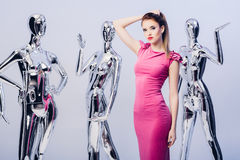 Beautiful blond woman in pink evening dress on background of man Royalty Free Stock Image