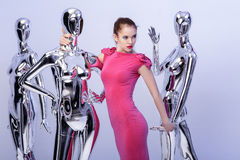 Beautiful blond woman in pink evening dress on background of man Royalty Free Stock Photography