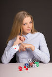Beautiful blond woman with playing card hidden under sleeve. Young beautiful blond woman with playing card hidden under sleeve Stock Photos
