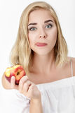Beautiful blond woman with pleasure eating nectarine Royalty Free Stock Photography