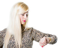 Beautiful blond woman portrait checking wrist watch Stock Photo