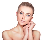 Beautiful Blond Woman Portrait on White Background. Face Beauty. Close-Up portrait of young beautiful girl with perfect skin on white background Royalty Free Stock Photos