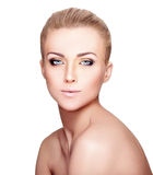 Beautiful Blond Woman Portrait on White Background. Face Beauty. Close-Up portrait of young beautiful girl with perfect skin on white background Stock Image