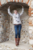 Beautiful blond woman posing in brick niche Stock Images