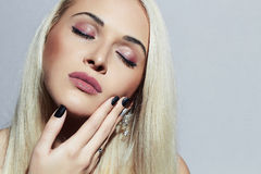Beautiful blond Woman with professional make-up. Sexy Beauty Girl. Shellac manicure Royalty Free Stock Photography