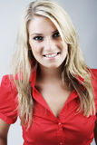 Beautiful blond woman in a red blouse Royalty Free Stock Photography