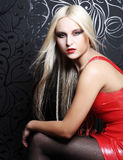 Beautiful blond woman with red dress. Royalty Free Stock Image