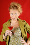 Beautiful blond woman with red drink Royalty Free Stock Photo