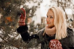 Beautiful blond woman in red gloves winter photo stock image