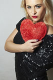 Beautiful Blond Woman with Red Heart. Beauty Girl. Show Love Symbol. Valentine's Day. Black Dress Stock Photos