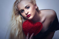 Beautiful Blond Woman with Red Heart. Beauty Girl. Show Love Symbol. Valentines Day Royalty Free Stock Photo