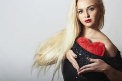 Beautiful Blond Woman with Red Heart. Beauty Girl. Show Love Symbol. Valentines Day. Portrait of Beautiful Blond Woman with Red Heart. Beauty Girl. Show Love royalty free stock photo