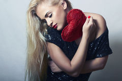 Beautiful Blond Woman with Red Heart. Beauty Girl. Show Love Symbol. Valentines Day Stock Photography