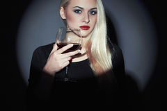 Beautiful blond woman with red wine.drinking girl. Beautiful blond woman with red wine.make-up.red lips.wineglass.drinking girl Stock Photography