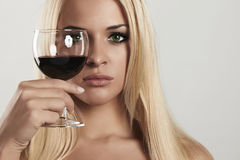 Beautiful blond woman with red wine.make-up.red lips.wineglass.drink. Portrait of Beautiful blond woman with red wine.make-up.red lips.wineglass.drink Royalty Free Stock Photography