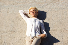 Beautiful blond woman resting with eyes closed Royalty Free Stock Photos