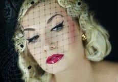 Beautiful blond woman retro portrait. Royalty Free Stock Photo