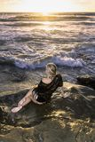 Blond girl by the ocean royalty free stock photos