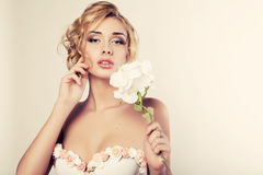 Beautiful blond woman with rose Stock Images