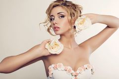 Beautiful blond woman with roses Royalty Free Stock Photo