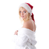 Beautiful blond woman in santa hat Stock Images