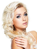 Beautiful blond woman with saturated makeup. Stock Images