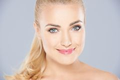 Beautiful blond woman with a serene smile Royalty Free Stock Photos