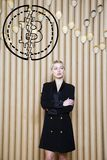 Beautiful blond woman showing standing near bitcoin sketch. Virtual money or btc crush concept. Cryptocurrency. stock image