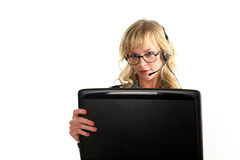 Beautiful blond woman sitting with laptop stock photography