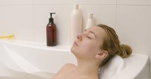 Beautiful woman sleeping in bath. stock video