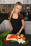 Beautiful Blond Woman Slicing Vegetables Royalty Free Stock Photo