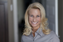 Beautiful blond woman smiling at the camera Royalty Free Stock Photo